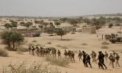 In this March 7, 2015, file photo, Chadian troops and Nigerian special forces participate in the Flintlock exercises with the U.S. military and its Western partners in Mao, Chad. The Pentagon told The Associated Press on Oct. 27, 2017, that there is no truth to claims in a viral story that Sgt. La David Johnson betrayed his fellow soldiers in an ambush that killed him and three of his comrades in Niger earlier this month. (AP Photo/Jerome Delay, File)